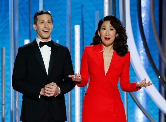 Golden Globes hosts Andy Samberg, left, and Sandra Oh (mostly) played nice in their opening monologue.