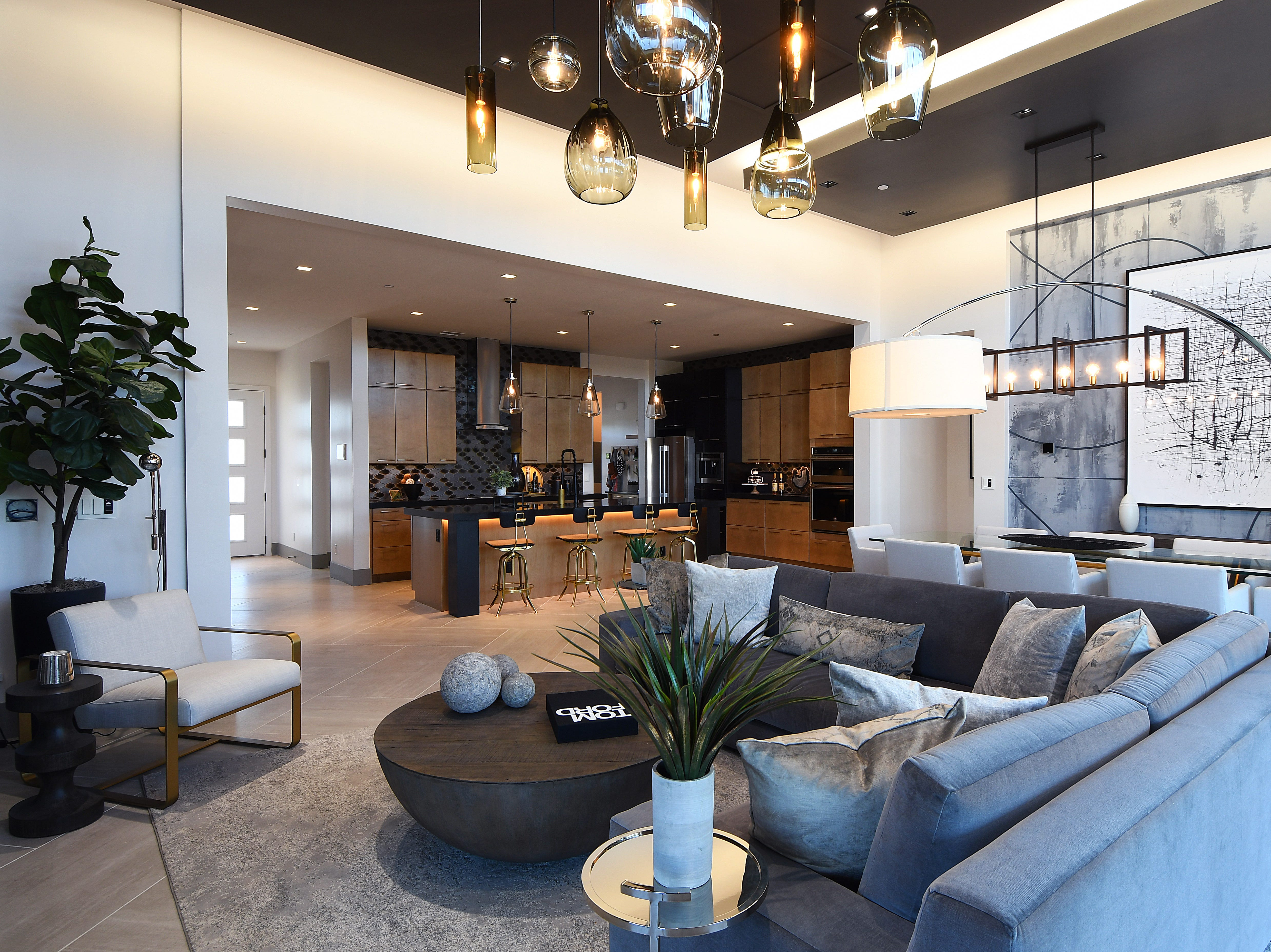 The living room and dining area in the KB Projekt smart home.