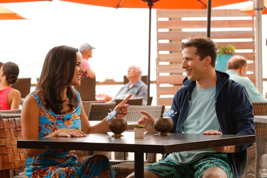 Newlywed police colleagues Amy (Melissa Fumero) and Jake (Andy Samberg) go on their honeymoon in the Season 6 premiere of NBC's 'Brooklyn Nine-Nine.'