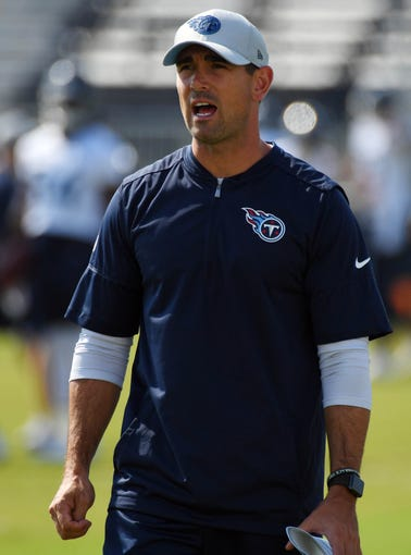 Tennessee Titans offensive coordinator Matt LaFleur walks with quarterbacks during training camp at Saint Thomas Sports Park.