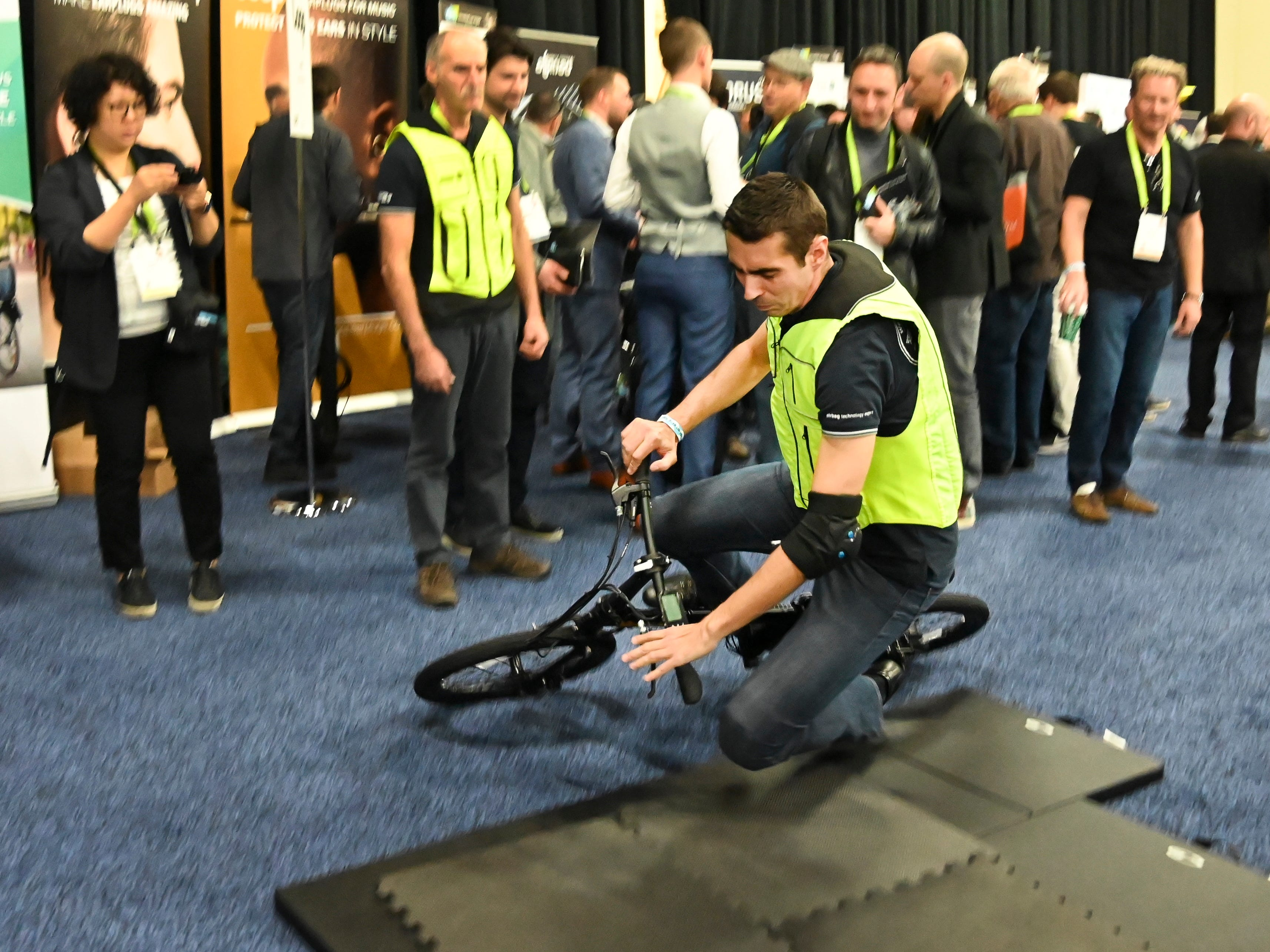 Andrew Quarrey of B'Safe demonstrates the company's smart airbag vest for cyclists.