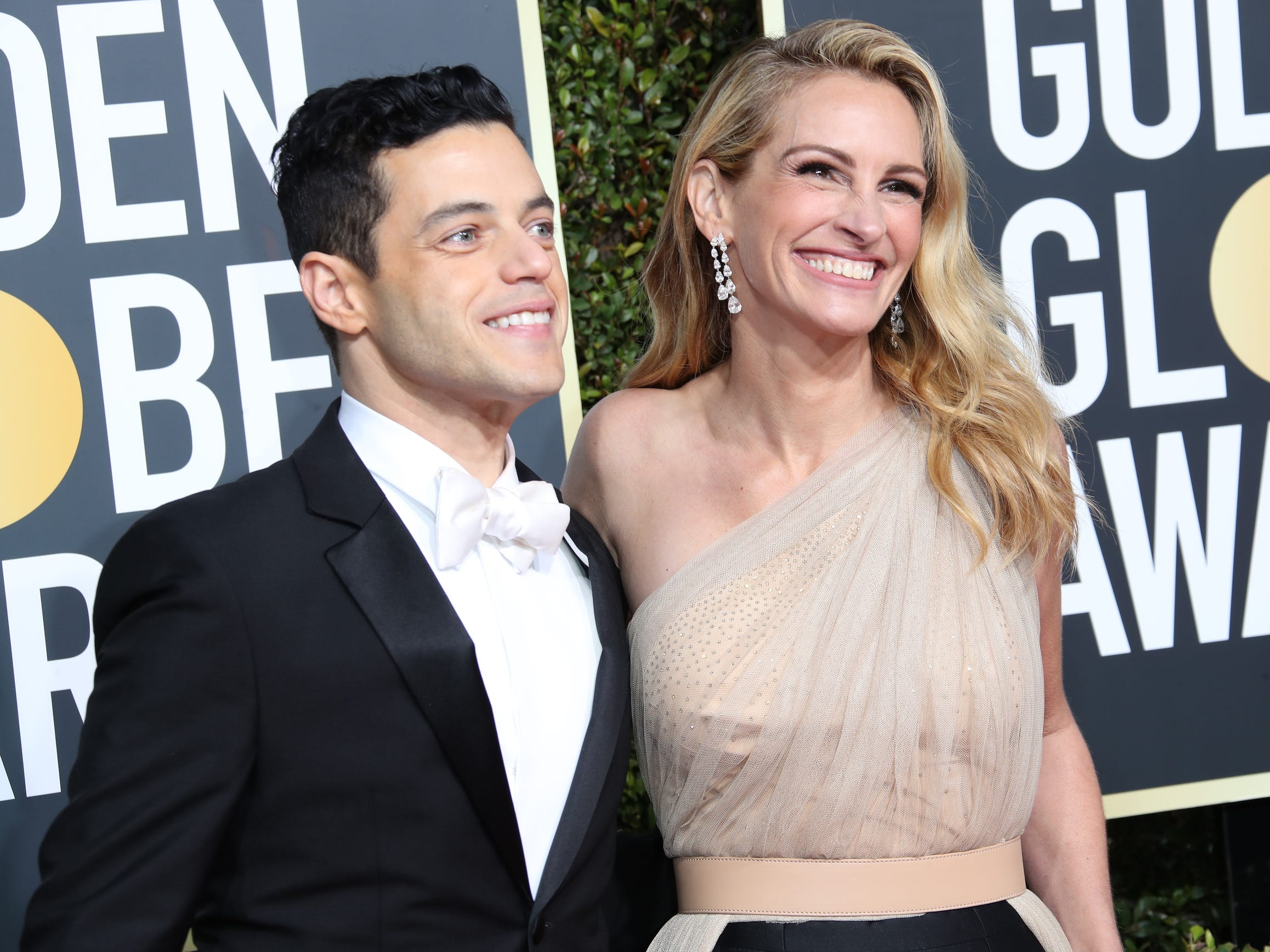 Rami Malek, left and Julia Roberts arrive  on the 76th Golden Globe Awards red carpet.