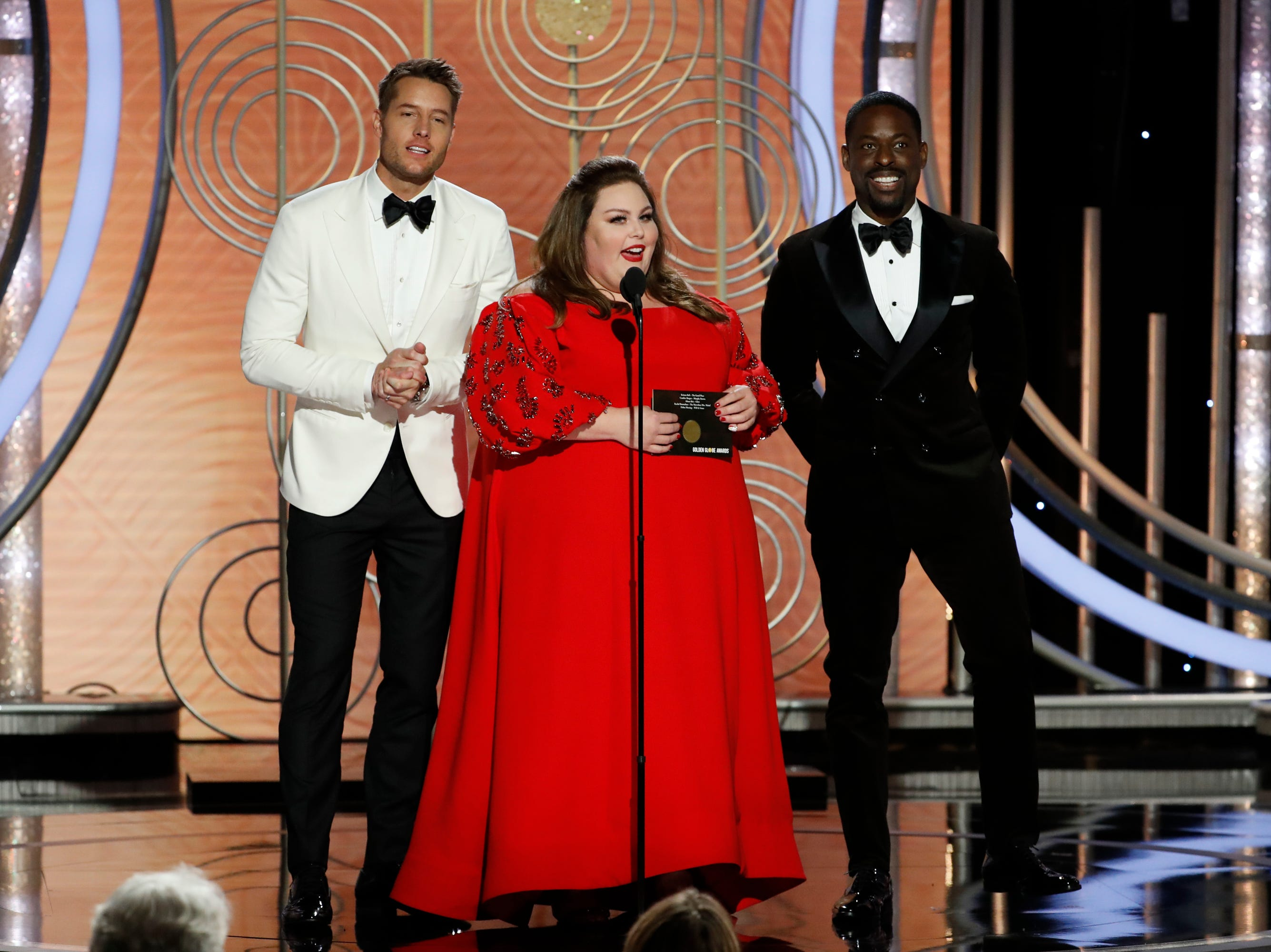BEVERLY HILLS, CALIFORNIA - JANUARY 06: In this handout photo provided by NBCUniversal, pRESENTERS Justin Hartley, Chrissy Metz and Sterling K. Brown speak onstage during the 76th Annual Golden Globe Awards at The Beverly Hilton Hotel on January 06, 2019 in Beverly Hills, California.  (Photo by Paul Drinkwater/NBCUniversal via Getty Images) ORG XMIT: 775268380 ORIG FILE ID: 1078415012