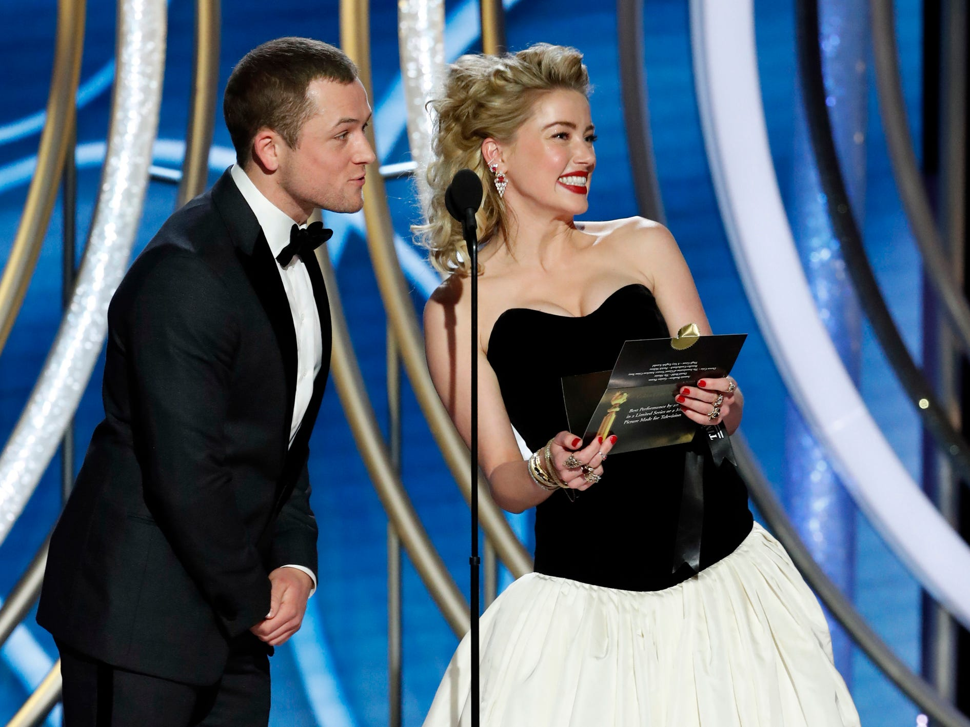 Taron Egerton and Amber Heard present during the 76th Golden Globe Awards.