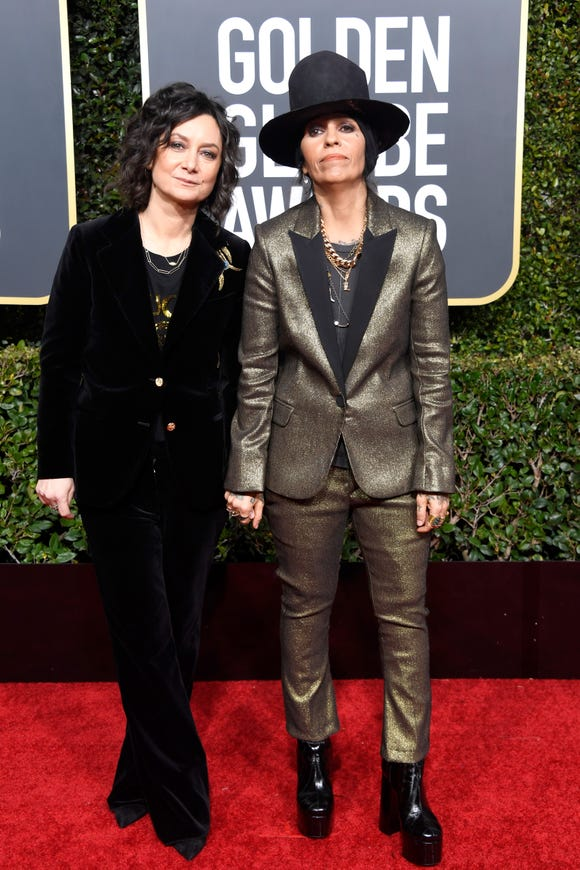 Linda Perry, right, who walked the red carpet with wife Sara Gilbert, is feeling philanthropic.