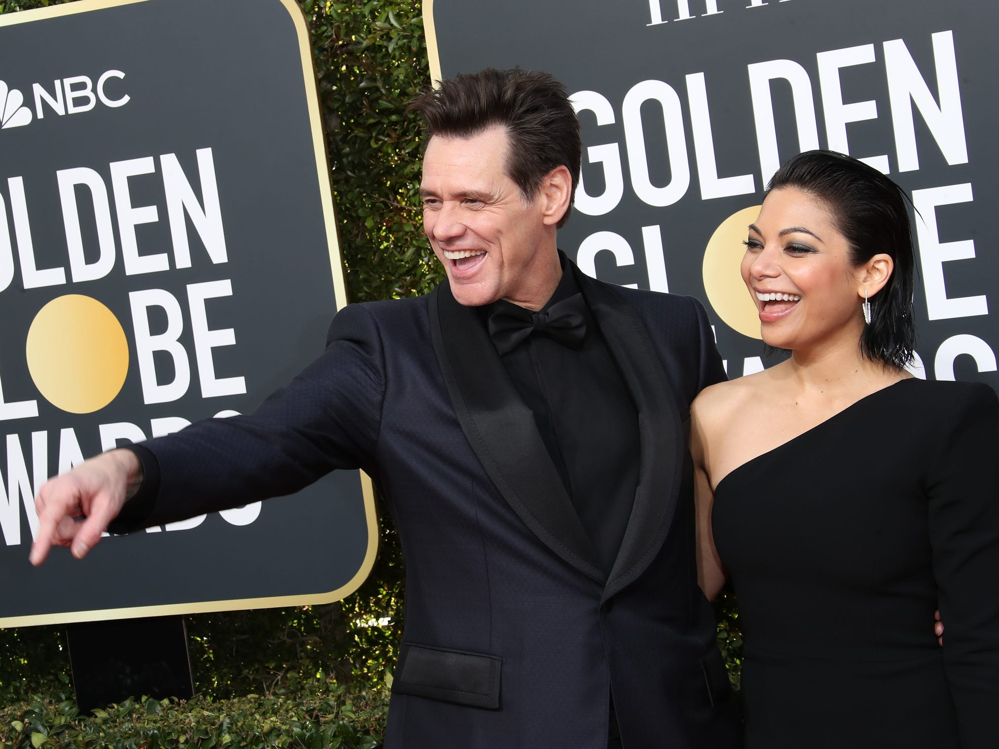 Jim Carrey, left and Ginger Gonzaga arrive.