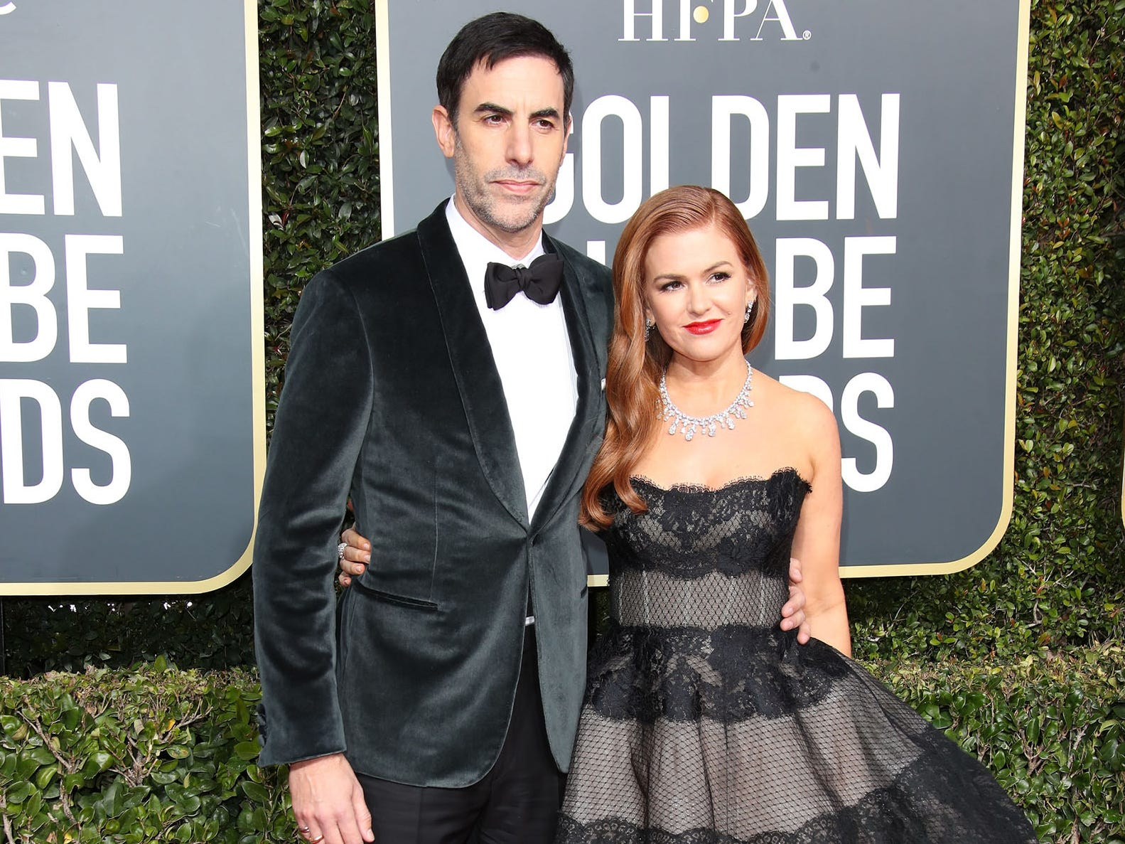 Sacha Baron Cohen, left and Isla Fisher