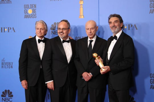 'The Kominsky Method' actors and producers Michael Douglas, left, Al Higgins, Alan Arkin and Chuck Lorre show off their Golden Globe for best musical or comedy TV series.