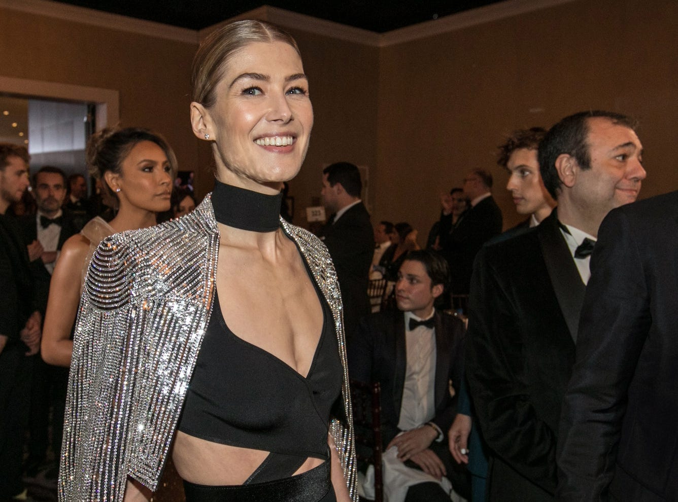 "Rosamund Pike, nominated for drama actress for ""A Private War,"" shimmers in a silver cape."