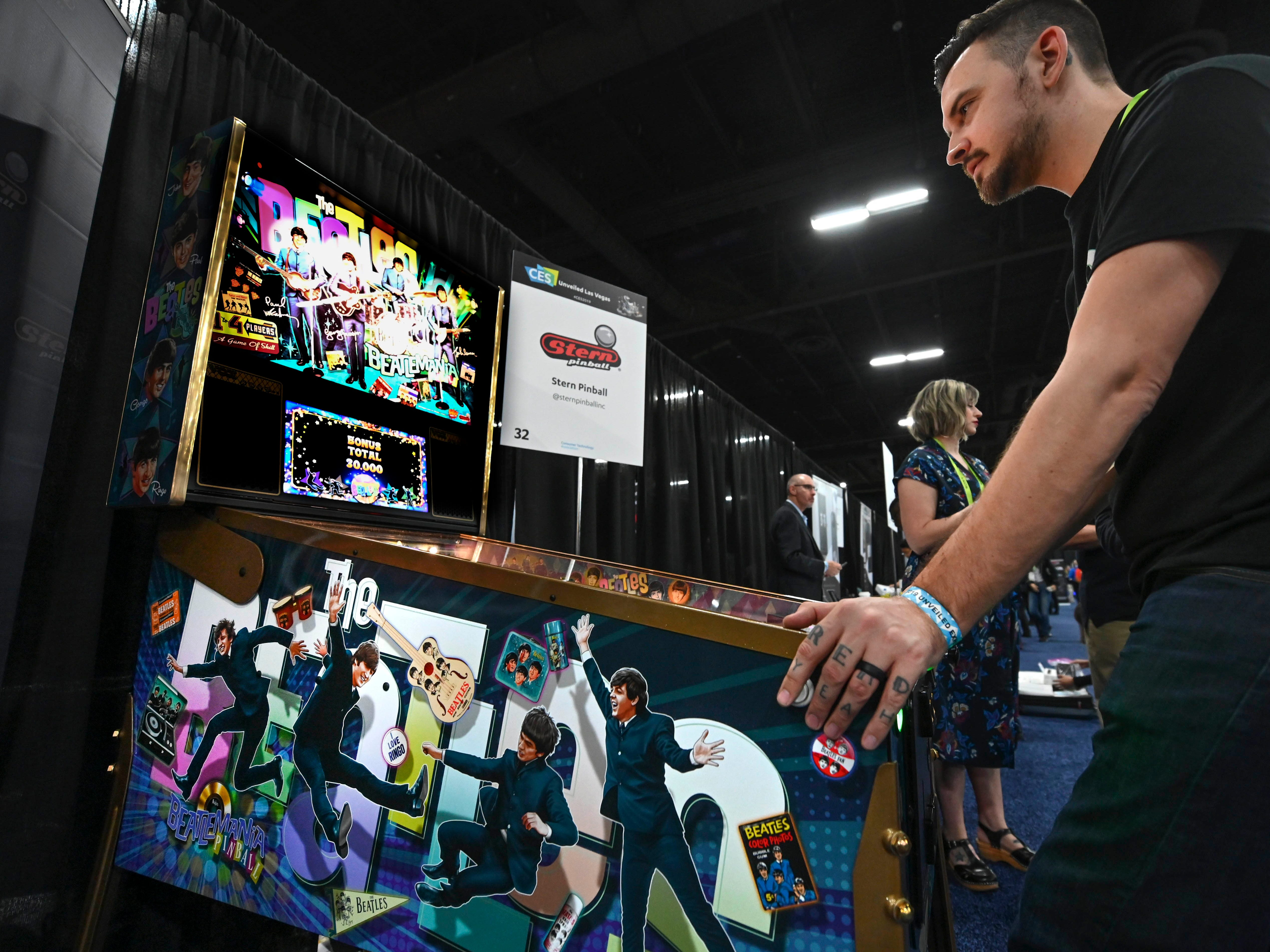 January 6, 2019; Las Vegas, NV, USA;  Jack Danger plays Stern Pinball's latest game based on The Beatles at CES Unveiled, a media preview event at the Mandalay Bay Convention Center. The pinball machine features nine hit Beatles song plus audio from John, Paul, George and Ringo. Mandatory Credit: Robert Hanashiro- USA TODAY NETWORK ORIG FILE ID:  20190106_ajw_usa_976.jpg