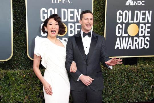 Hosts Sandra Oh and Andy Samberg arrive at the 76th Golden Globe Awards.