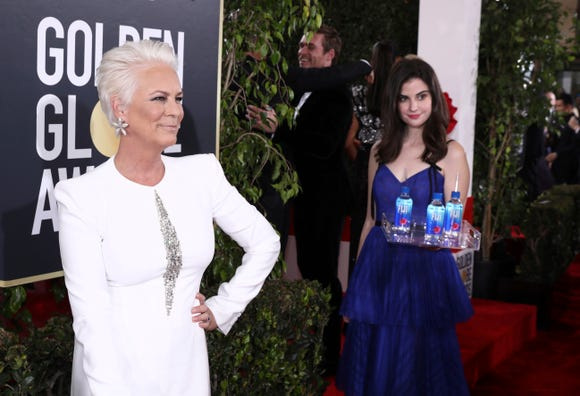 FIJI Girl photo bombs Jamie Lee Curtis at the 76th annual Golden Globe® Awards Sunday, Jan. 6, 2019 in Beverly Hills, Calif. (Photo: Matt Sayles, Invision for FIJI Water)