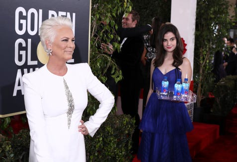 FIJI Girl photo bombs Jamie Lee Curtis at the 76th annual Golden Globe® Awards Sunday, Jan. 6, 2019 in Beverly Hills, Calif.