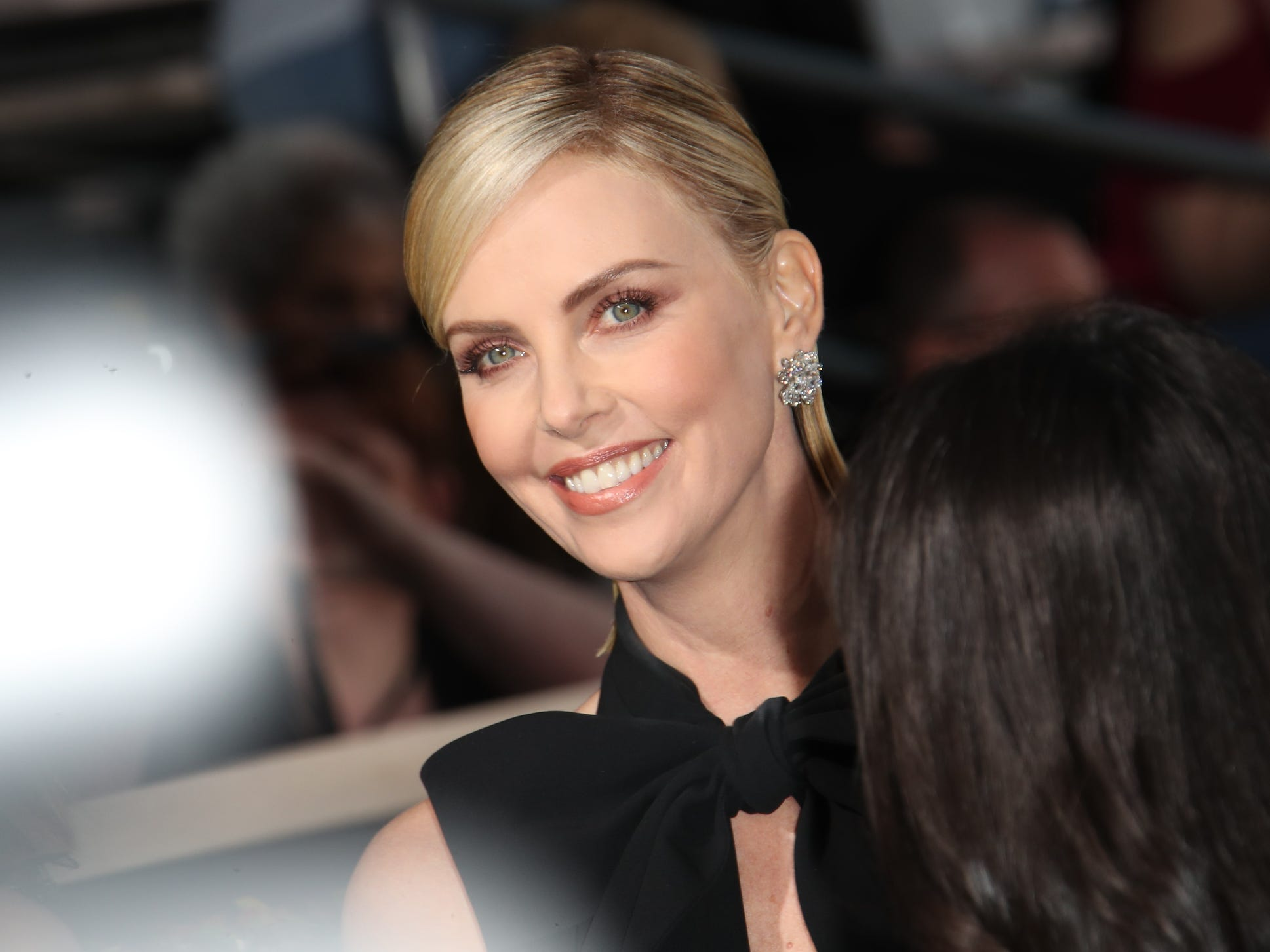 Charlize Theron arrives.