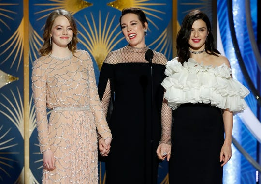 "Olivia Colman, center, with her ""The Favourite"" co-stars Emma Stone, left, and Rachel Weisz, took best actress in a comedy, her second Golden Globe win."