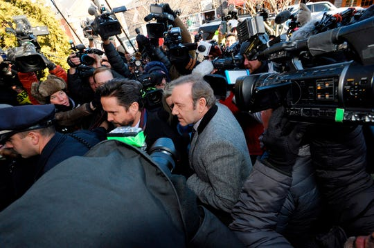 Kevin Spacey and his lawyer Alan Jackson wade through a media frenzy for his arraignment on Jan. 7, 2019 at the Nantucket District Court, on Nantucket, Mass.