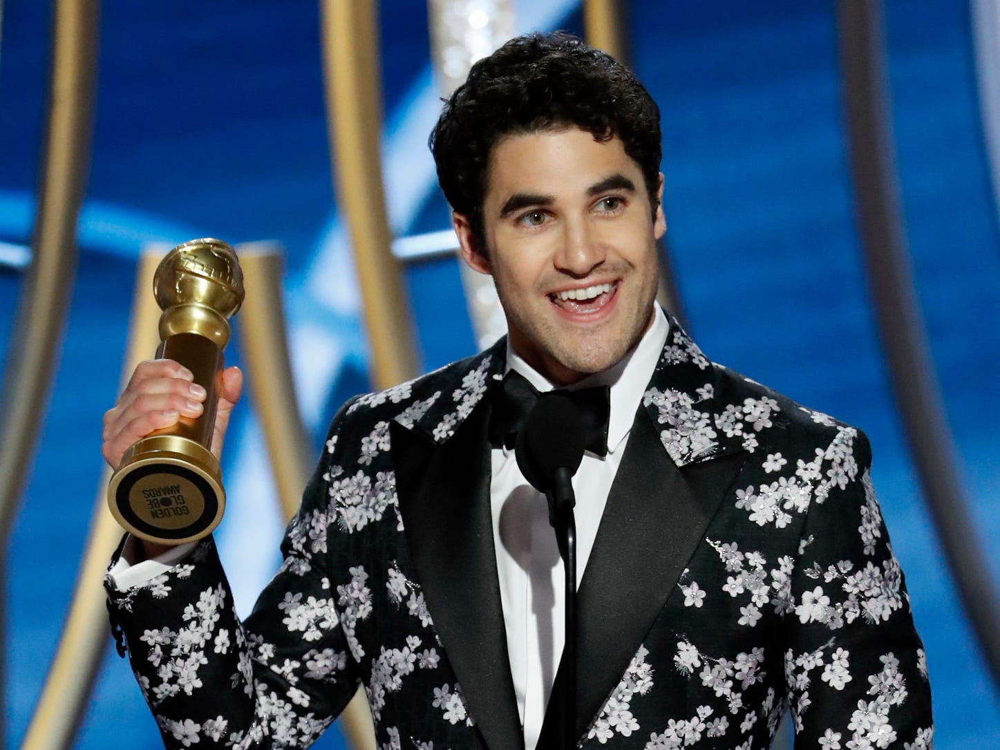 Darren Criss accepts the award for Best Actor - Limited Series or Picture Made for Television during the 76th Golden Globe Awards.