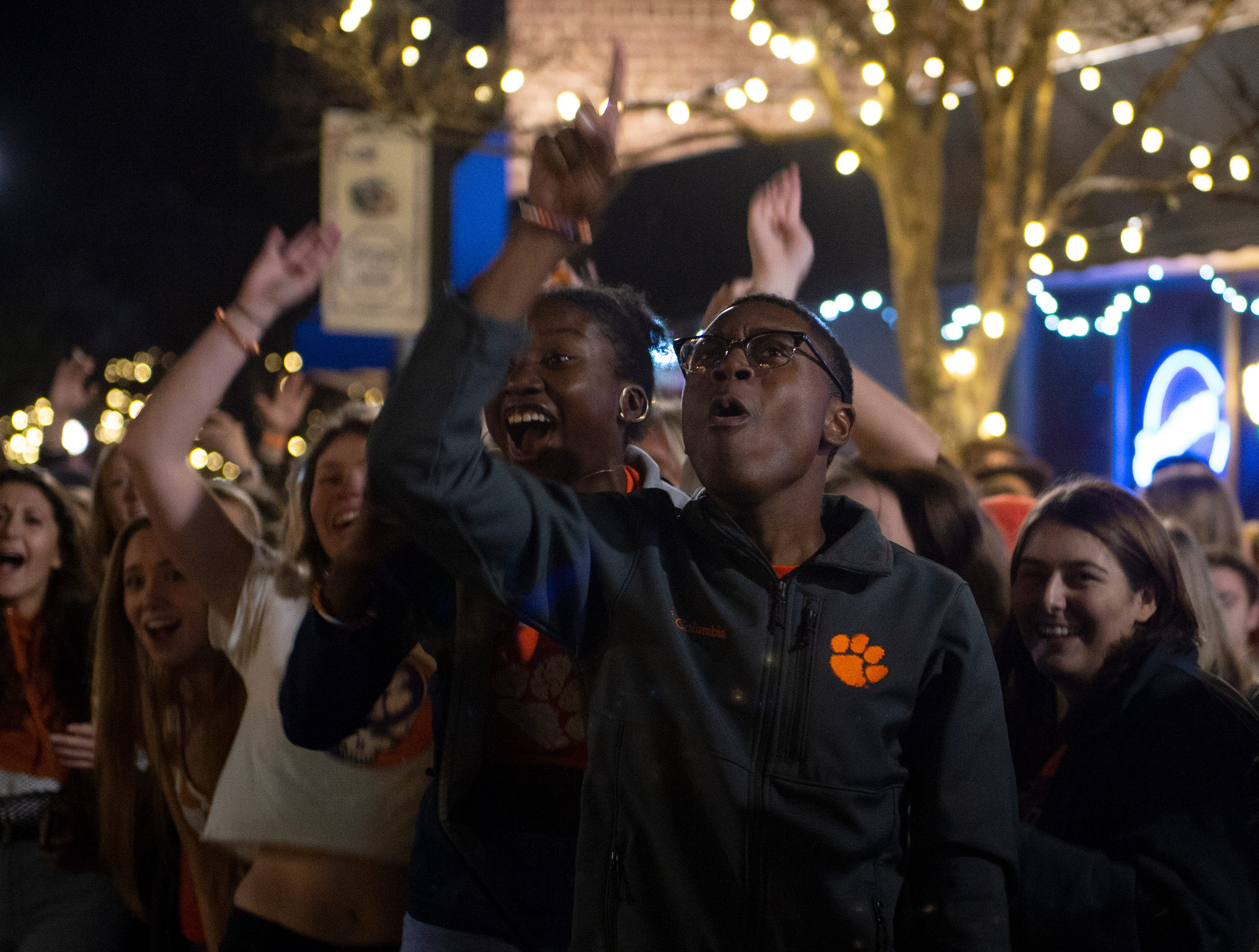 Clemson freshman True Miles (right) and Alana Choate gather on College Avenue to watch Clemson play Alabama in the College Football Playoff National Championship Monday, Jan. 7, 2019.