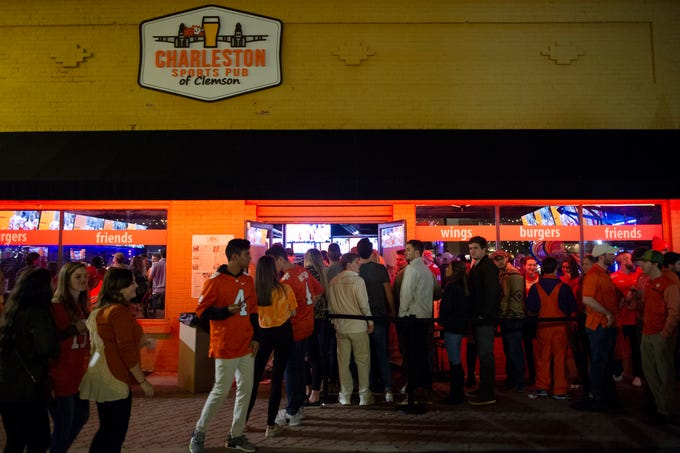 Clemson fans line up to enter Charleston Sports Pub of Clemson before Clemson plays Alabama in the College Football Playoff National Championship Monday, Jan. 7, 2019.
