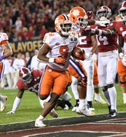Travis Etienne scores on a shovel pass from Trevor Lawrence in the first half of the National Championship game.