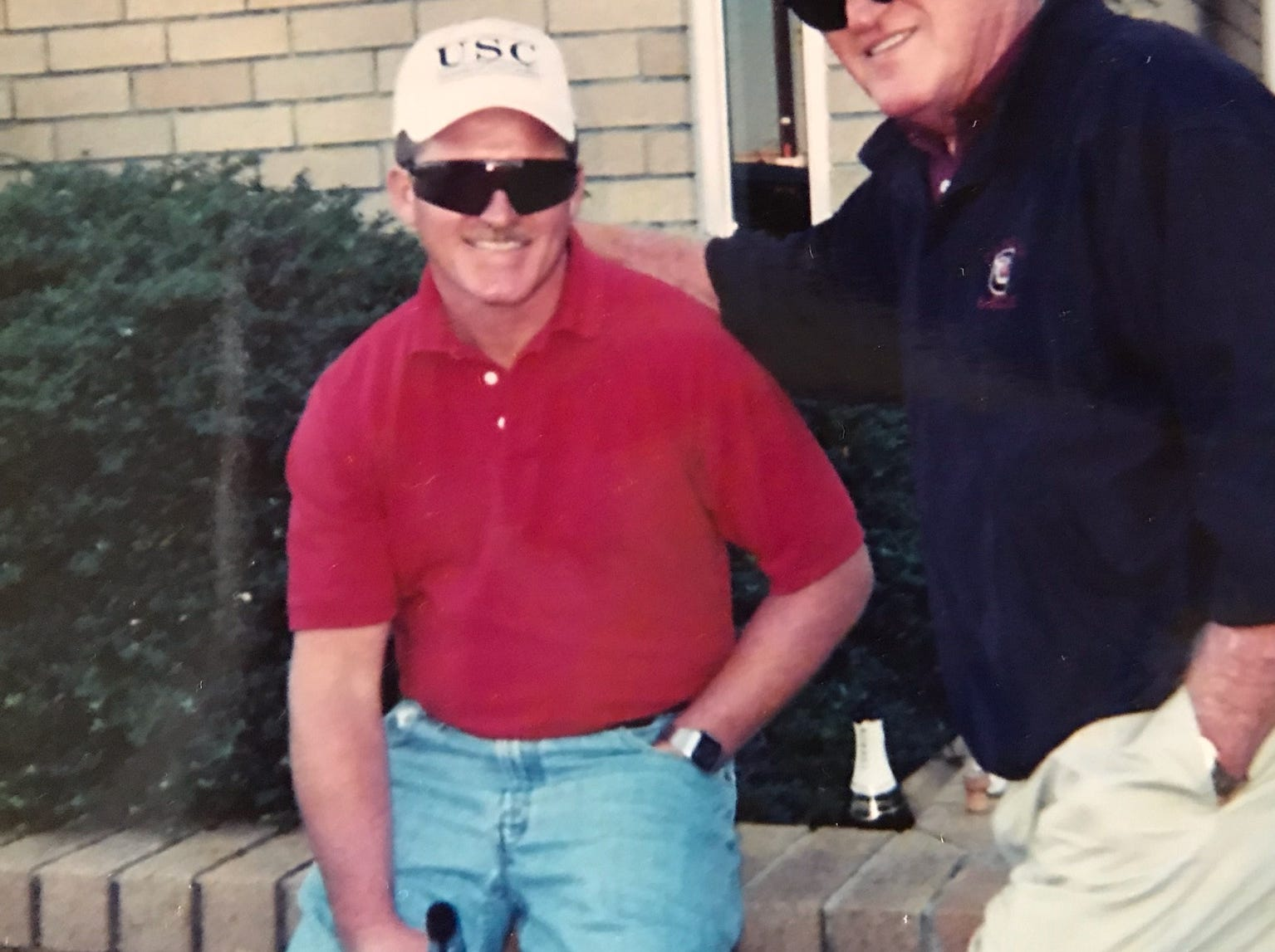 Dale Martin and his son Vic Martin pose for a picture with their University of South Carolina caps.