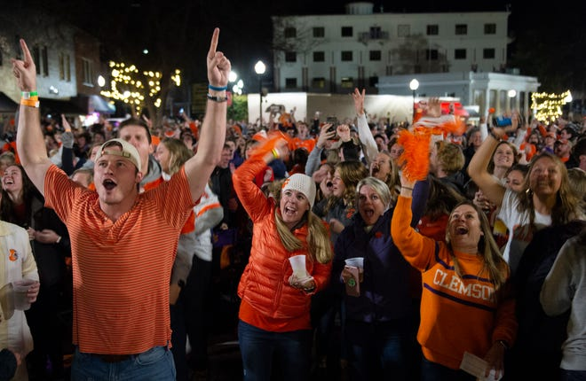 Clemson fans celebrate the first touchdown while gathered on College Avenue to watch Clemson play Alabama in the College Football Playoff National Championship Monday, Jan. 7, 2019.