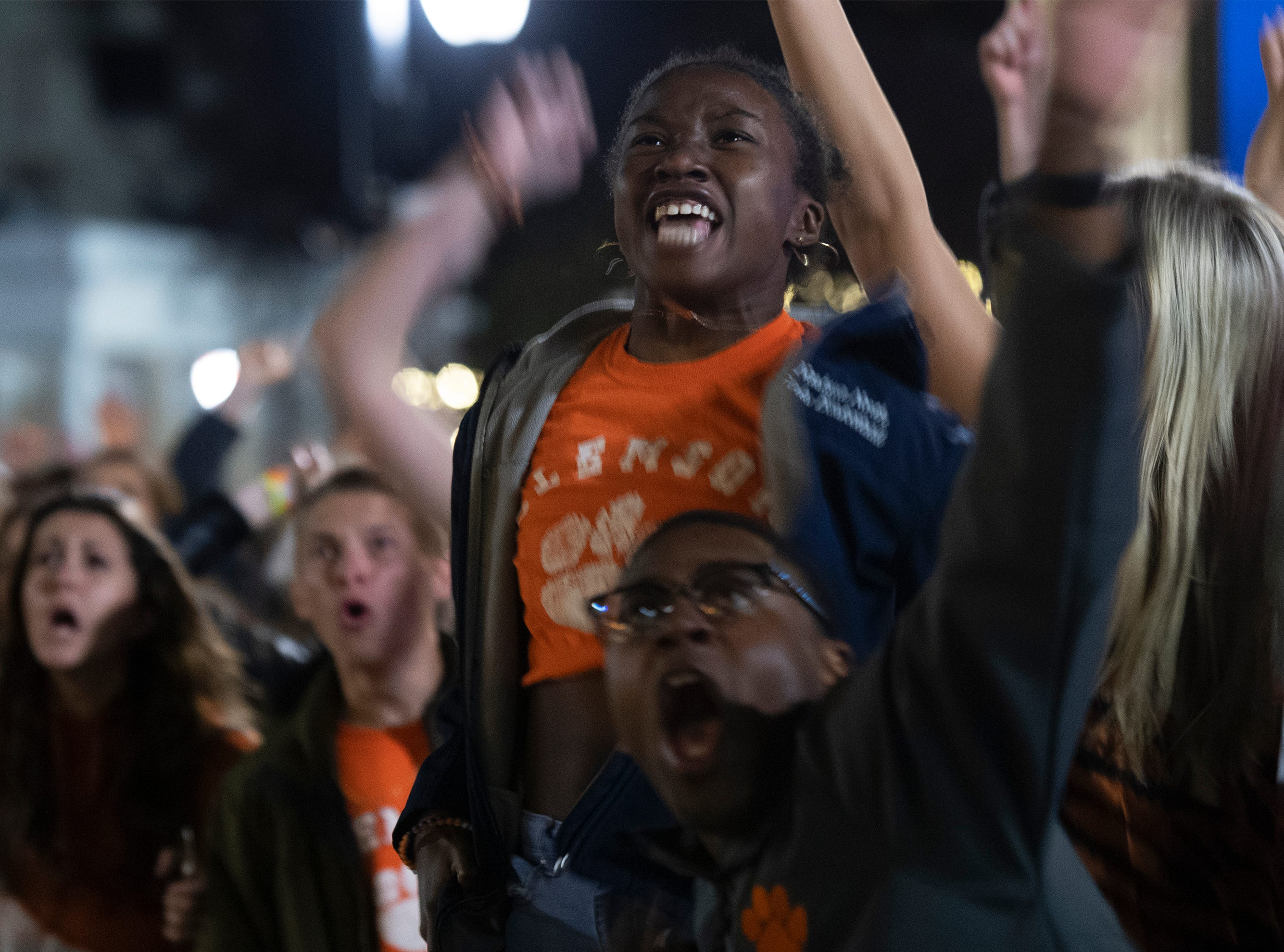 Freshman Alana Choate, 19, cheers while Clemson plays Alabama in the College Football Playoff National Championship Monday, Jan. 7, 2019.