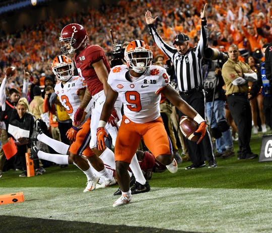Travis Etienne scores a touchdown in the National Championship against Alabama.