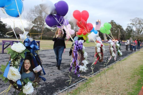 Balloons are tied to wreaths for the five Marksville children who died on Jan. 3 in a wreck near Gainesville, Florida, at a vigil held days later at Marksville High School. Investigations into the crash are continuing, but the National Transportation Safety Board released a preliminary report on the crash Wednesday.