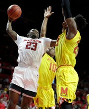 Rutgers guard Montez Mathis (23) goes up for a shot against Maryland guard Serrel Smith Jr. (10) and forward Jalen Smith (25)