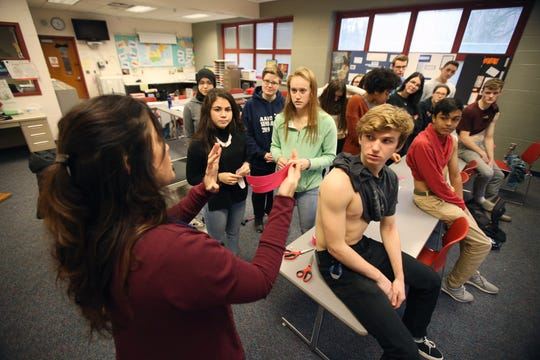 Dr. Angela Dineen, a physical therapist of Belmar who has been teaching for 16 years, demonstrates kinesiology taping techniques during her Intro to Physical Therapy class at Monmouth County Academy of Allied Health and Science in Neptune, NJ Tuesday January 8, 2019.