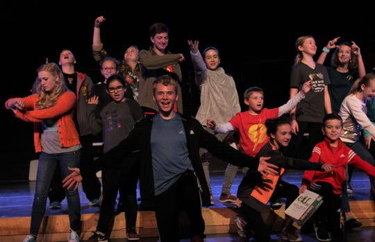 "The cast of ""Elf Jr."" strikes a pose at the conclusion of a musical number led by Buddy (Brent Bardin, center), in this first-day rehearsal scene from the Paramount Theatre production that opens Jan. 18."