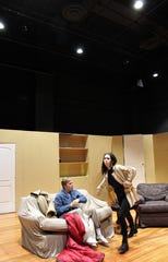 Artie (Wesley Horn) and Bunny (Anna Claire Boone) in an apartment scene set up within the black walls of Wylie High School's new Black Box Theatre.
