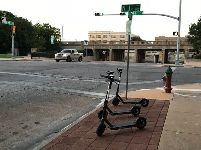 A nest of Bird electric, shareable scooters parked in downtown Abilene on Friday, Aug. 24, 2018.