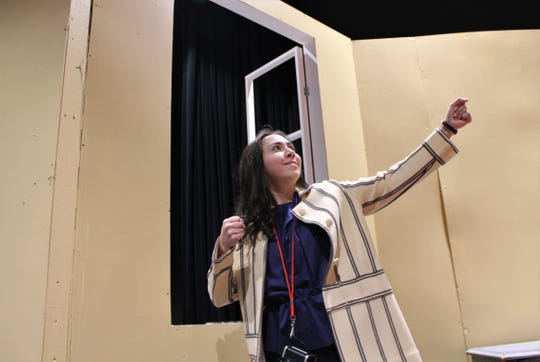 """Anna Claire Boone is Bunny, who strikes a pose near a window that separates the audience in the Black Box Theatre in the Wylie ISD's new Performing Arts Center. """"xxx Blue Leaves"""" is the first production in the new facility."""