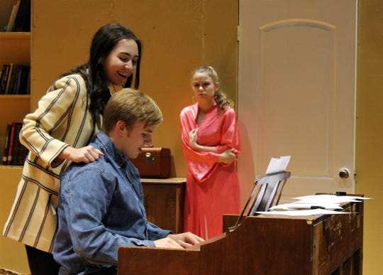 """Artie Shaughnessy (Wesley Horn) at the piano with his girlfriend Bunny (Anna Claire Boone) behind him, not knowing Artie's wife (Marley Gamble) is witness to their flirtation in this rehearsal scene from """"The House of Blue Leaves."""""""
