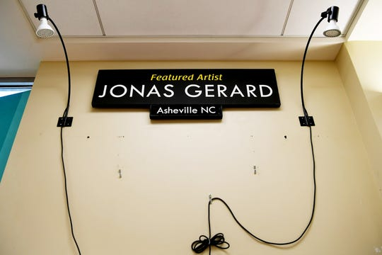 An advertising display of Jonas Gerard's work at the Asheville Regional Airport is bare Jan. 8, 2019, after his artwork was vandalized multiple times since the weekend, causing thousands of dollarsworth of damage. The incidents add to the more than a dozen instances targeting the local artist over the past year.