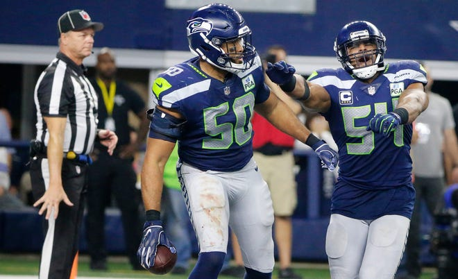 The Seahawks must decide this offseason whether to retain linebacker K.J. Wright (50). Next season, they'll face the same decision with their other veteran linebacker, Bobby Wagner (54).
