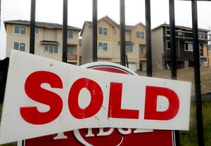 A sold sign adorns a home site at the Ridge development in Bremerton in January.