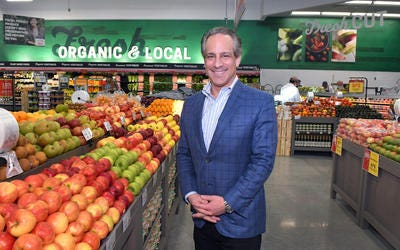 Frank Scorpiniti, Earth Fare president and CEO, poses next to part of the fresh produce section. Earth Fare, a healthy food grocery store chain that began in 1976, is opening a new store at Village Center, at the corner of Vieta Blvd. and Murrell Road in Viera. The grand opening is Wednesday