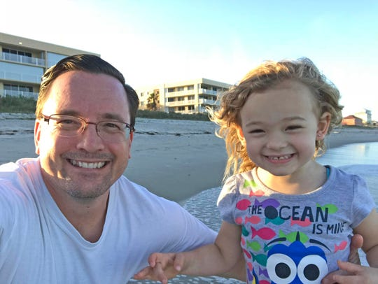 Daddy Duty columnist Tim Walters and daughter Isabella enjoy the beach on New Year's Day.