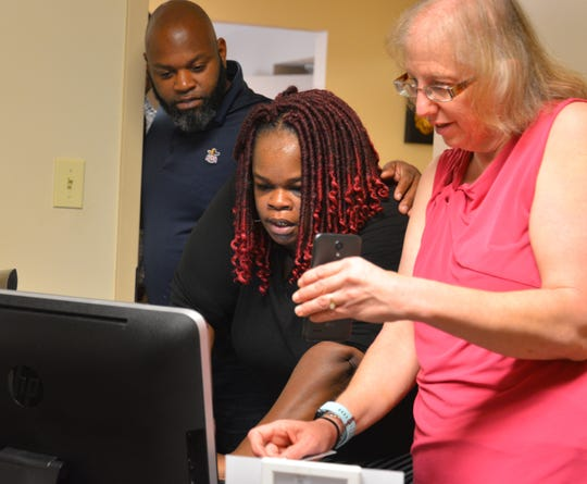 Based on the enactment of Amendment 4, beginning on Jan. 8 Brevard's Supervisor of Elections office began processing voter registration applications from individuals with prior felonies who are now eligible to to register to vote. Here, Dawn Feick, the associate pastor's wife at the City of Refuge Christian Center in Cocoa, helps Cecilia Thompson with her application.