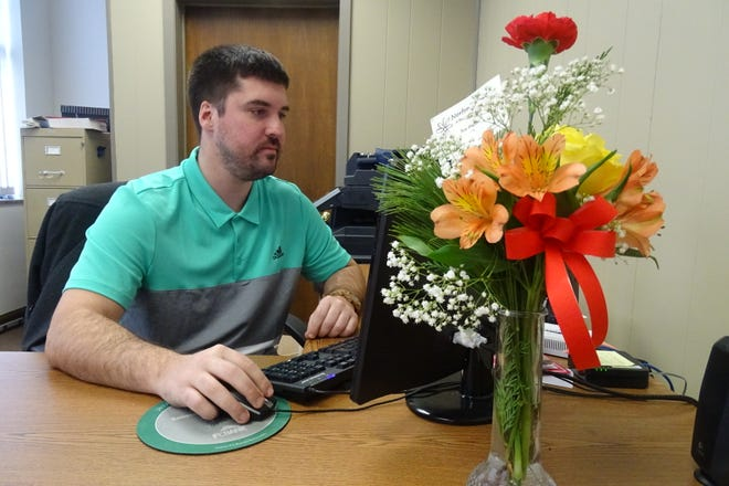 Max Miller, executive director of the Bucyrus Tourism and Visitors Bureau, works on a project in his office.