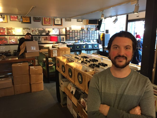 Owner Ian Doerner stands in the Bank Street location of Burlington Records. The store will move to College Street in February.