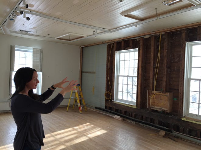 Rachel Moore, executive director of the Helen Day Art Center, describes how water cascaded down the walls of the building in Stowe that also contains the town's library.