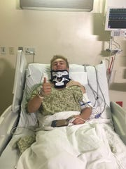 Coltan Wilkie gives the thumbs up in his hospital room shortly after his knee and neck injury in September of 2017.