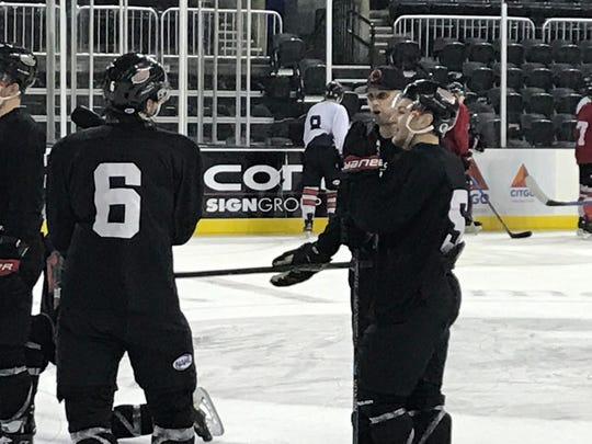 IceRays defenseman Coltan Wilkie, right, talks with coach Ryan Cruthers, second from right, and other IceRays players during a practice at the American Bank Center on Jan. 8, 2019.