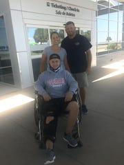 Colton Wilkie poses with his billet parents, Hollie and Chad Borchers, after his injury in September of 2017 at the Corpus Christi International Airport.