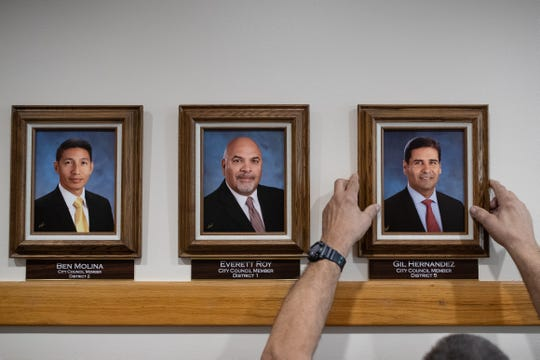 A photo of new City Council Member for District 5, Gil Hernandez is placed on the wall outside council chambers as the new council is sworn in at City Hall on Tuesday, Jan. 8, 2019.
