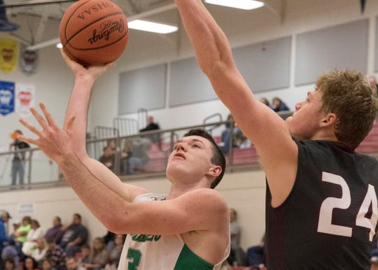 Elijah McCloskey scores against Vinton County earlier in the basketball season during the Zane Trace Tip-Off Classic at Zane Trace High School on Saturday, December 1, 2018.